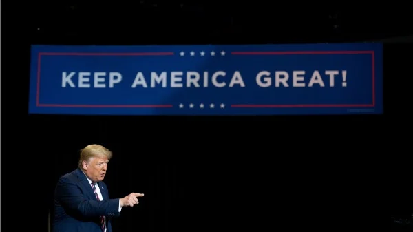 Trump still has several paths to victory in the 2020 U.S. election, but faces steep legal hurdles in all of them according to legal schoalr Alan Dershowitz. President trump points in foreground of sign with words on slogan saying