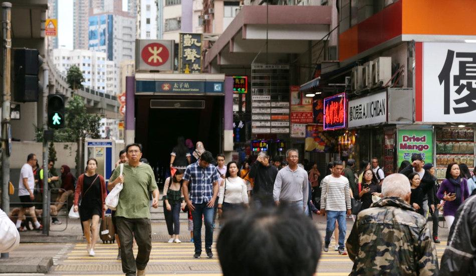 People crossing the street in Hong Kong.