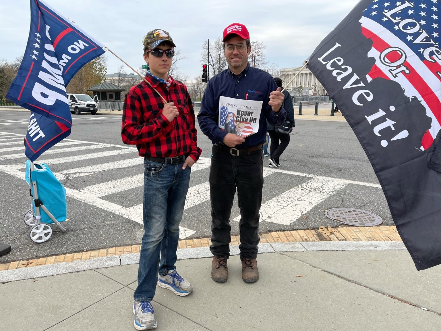 rally goers hold Vision Times Special Edition
