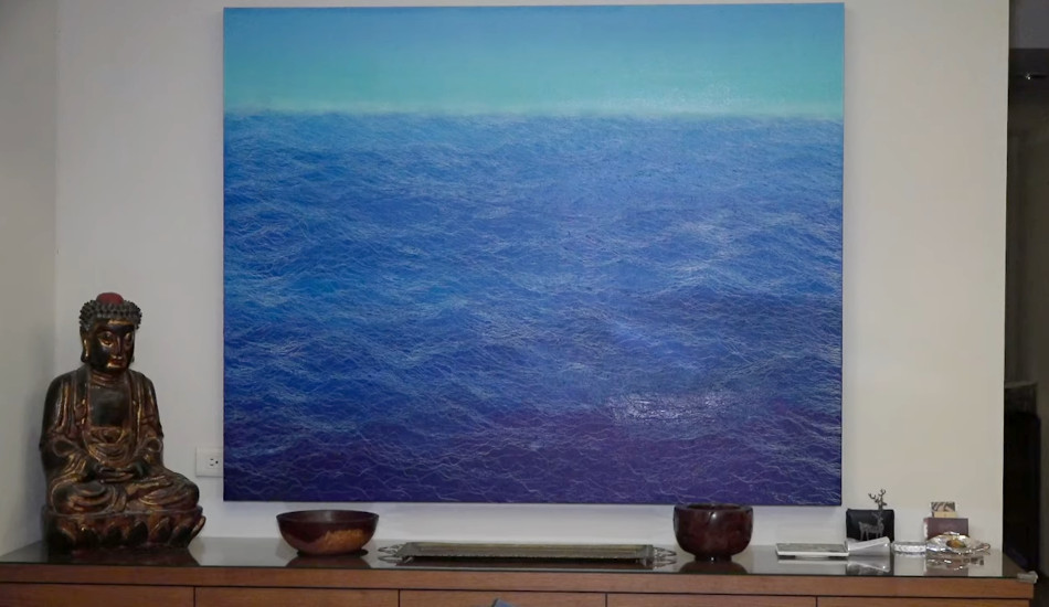 Some of the art in Stanton's home, a painting of blue ocean waves.