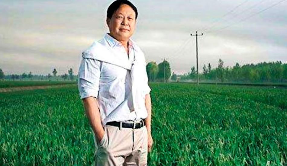 Sun Dawu standing in a field.