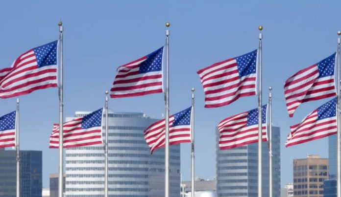 The U.S. flag flying from several flagpoles.