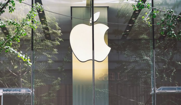 The Apple company logo at an Apple store.