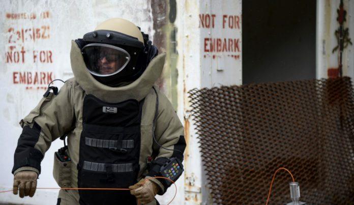 Man wearing a biohazard suit.