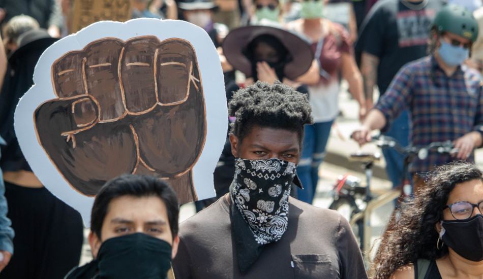 """Thousands of """"Black Lives Matter"""" protesters attend a rally during the pandemic."""