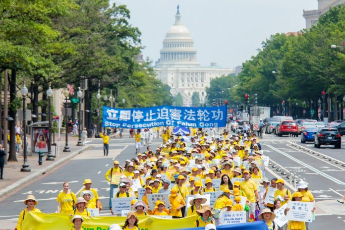 Falun Gong practitioners take part in a parade through Washington, D.C. in July 2017 to protest the Chinese regime's persecution of their faith. The U.S. Department of State (state department) led by Trump administration official Mike Pompeo has imposed the first U.S. sanctions on a CCP official for persecuting Falun Gong.