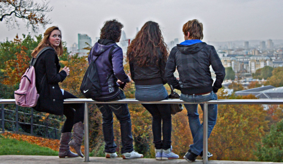 A group of young friends sit and talk together.