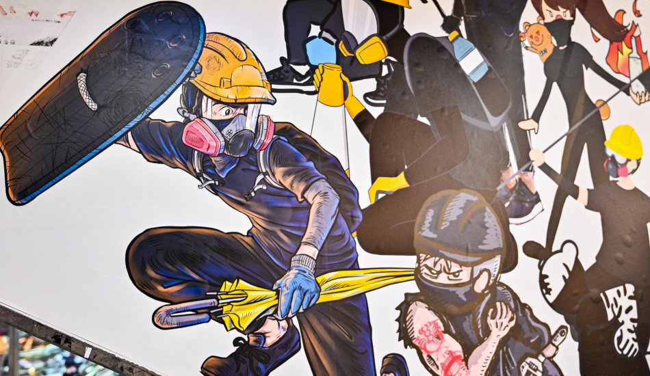 Artwork on the side of an escalator in a Hong Kong shopping mall showing anti-extradition protesters in cartoon form.
