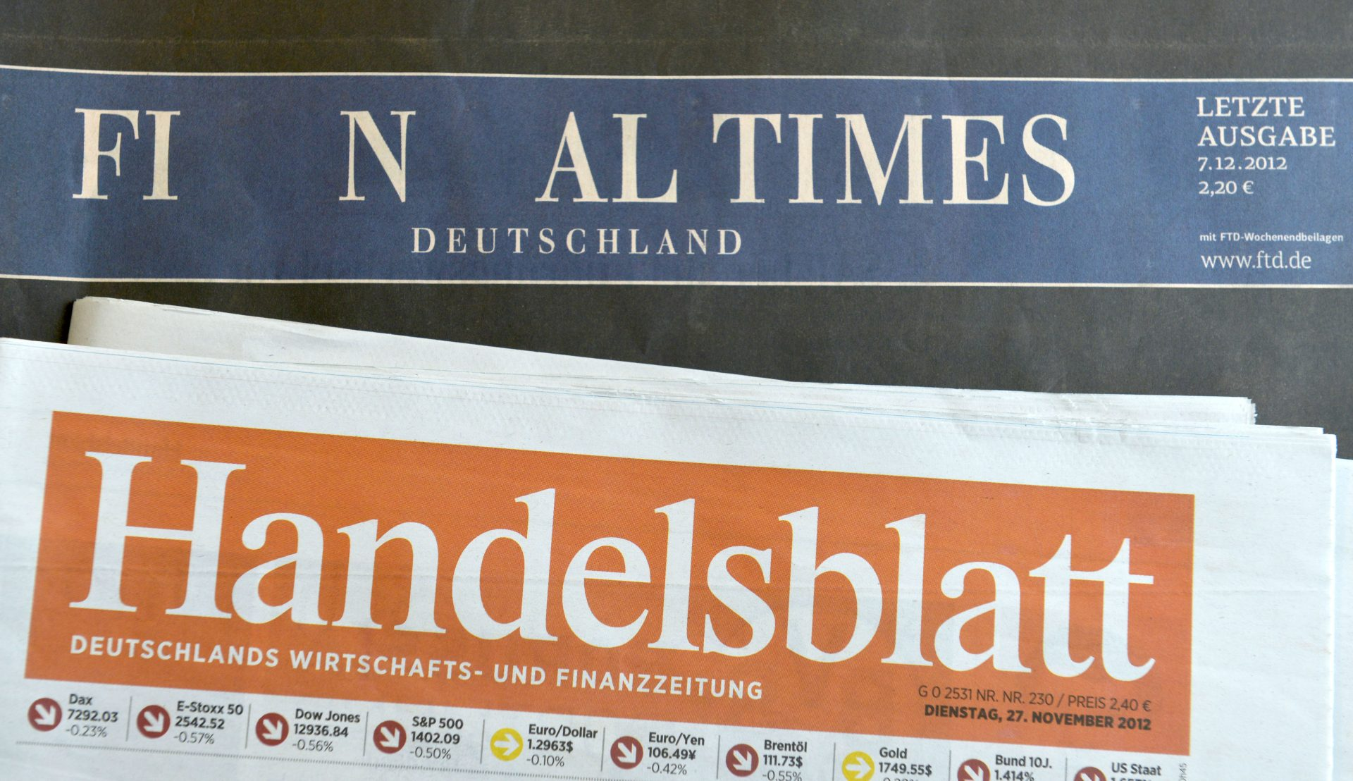 HAMBURG, GERMANY - DECEMBER 07: The final issue of the Financial Times Deutschland daily newspaper is seen on a issue of the Handelsblatt, its biggest competitioner, on December 7, 2012 in Hamburg, Germany. Gruner + Jahr launched the paper in 2000 and its management recently decided to cease publication given that the paper had failed every year to make a profit. Germany has been hit by several media bankruptcies in recent months, including the Frankfurter Rundschau daily newspaper and the DAPD news agency. (Photo by Patrick Lux/Getty Images)