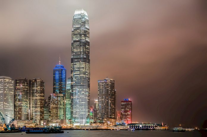 Hong Kong by nite. The skyline reflecting onto the harbour water.