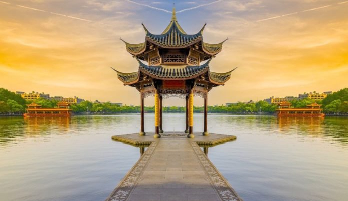 Pagoda at the edge of a lake in Asia.