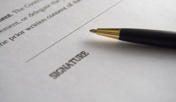 """Maricopa County apparently failed to validate the signatures on 1.9 million ballots.  The picture is a stock photo of a ball point pen on a piece of paper saying """"signature"""""""