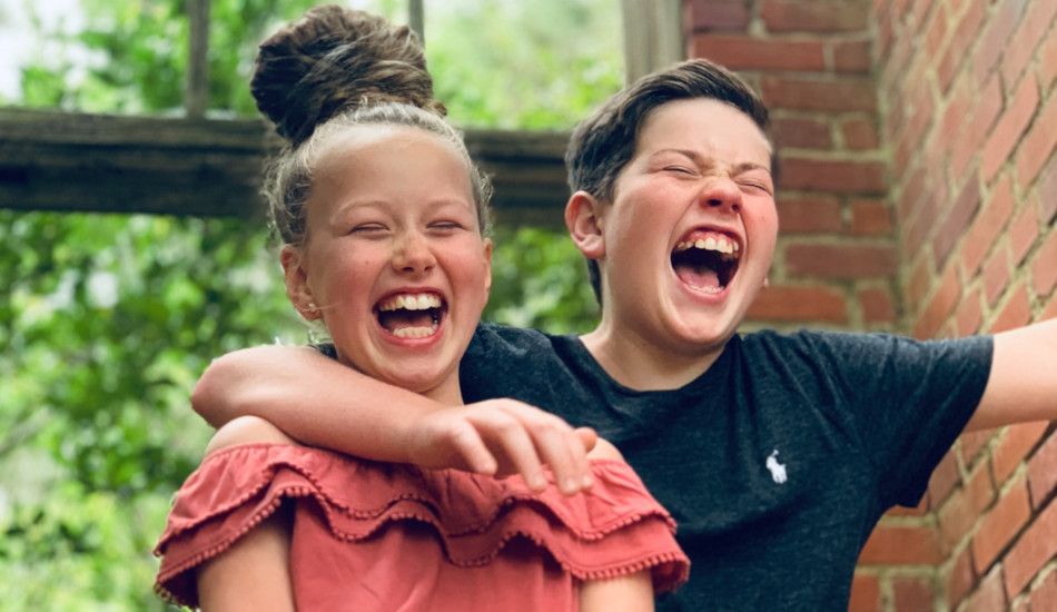 Girl and boy smiling.
