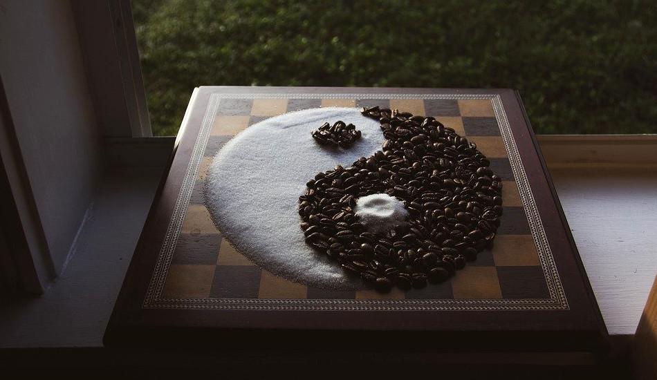 The yin-yang taiji symbol made from sugar and coffee beans.