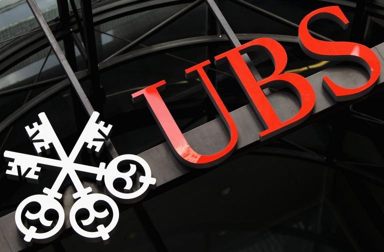 The sign for the UK headquarters of the Swiss banking group UBS after it was announced that unauthorised trades by an investment banker had cost the bank 1.3 billion GBP on September 15, 2011 in London, England. (Image: Oli Scarff/Getty Images)