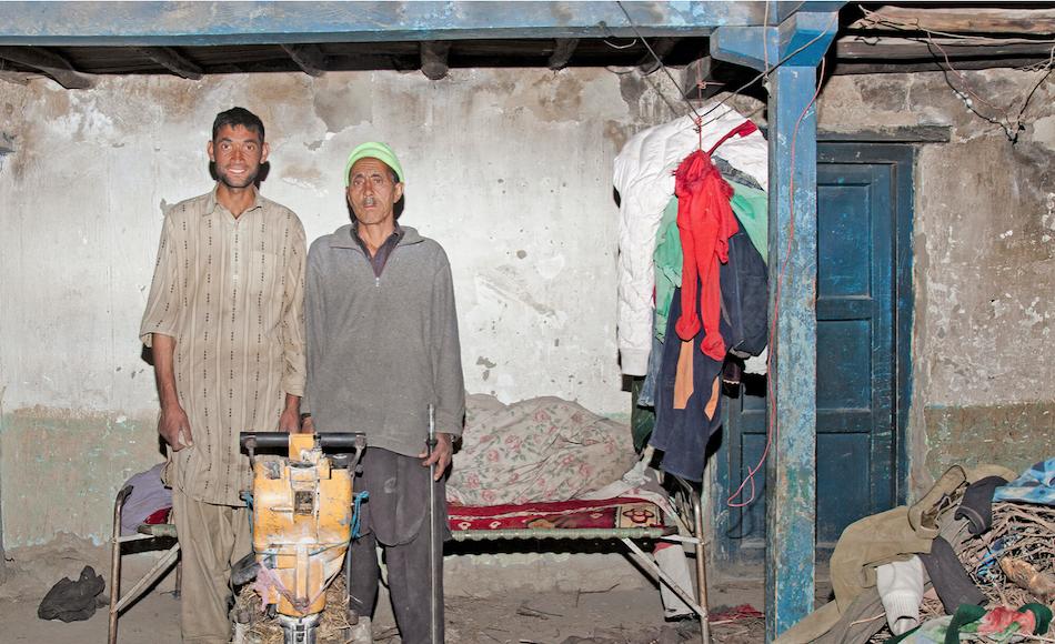 Miners Ibrahim Jalil and Gulam Nabi pose with a jackhammer in Hushe, Pakistan.