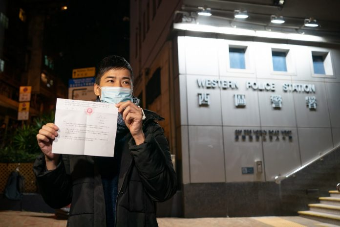 Pro-democracy activist Lester Shum shows his charge sheet to the members of the media after leaving Western Police Station on January 7, 2021 in Hong Kong, China. Over 50 Hong Kong opposition figures were arrested under the national security law in the largest operation yet against Beijing's critics, deepening a crackdown sweeping the financial hub. (Photo by Anthony Kwan/Getty Images)