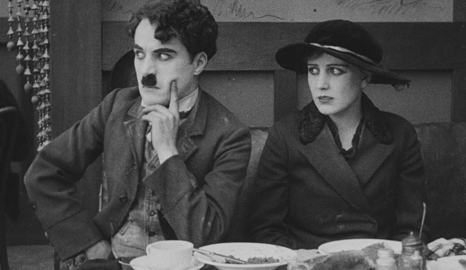 Charlie Chaplin and Edna in the restaurant scene.