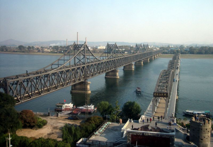 The two bridges on the Yalu River, Friendship Bridge (L) and Broken Bridge (R), that connect North Korea and China from Dandong province, on October 2008.