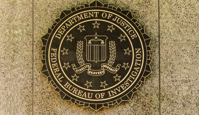 FBI emblem on the J. Edgar Hoover building in Washington, DC.