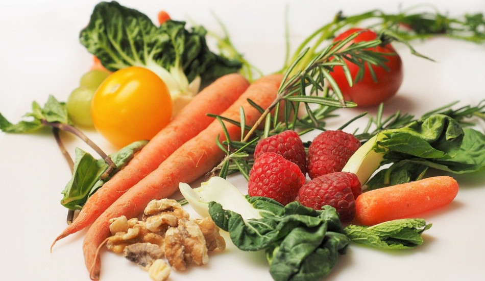 Fresh fruits and vegetables with nuts.
