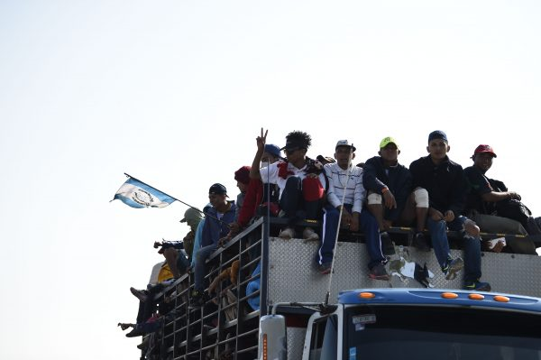 Central American migrants -mostly Honduran- taking part in a caravan to the US, are pictured on board a truck heading to Irapuato in the state of Guanajuato on November 11, 2018 after spending the night in Queretaro in central Mexico. - The United States embarked Friday on a policy of automatically rejecting asylum claims of people who cross the Mexican border illegally in a bid to deter Central American migrants and force Mexico to handle them. (Image: ALFREDO ESTRELLA/AFP via Getty Images)