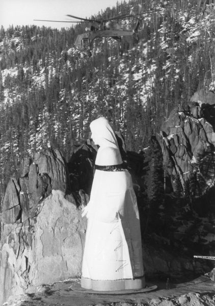 construction of lady of the rockies statue of virgin mary helicopter putting head on body