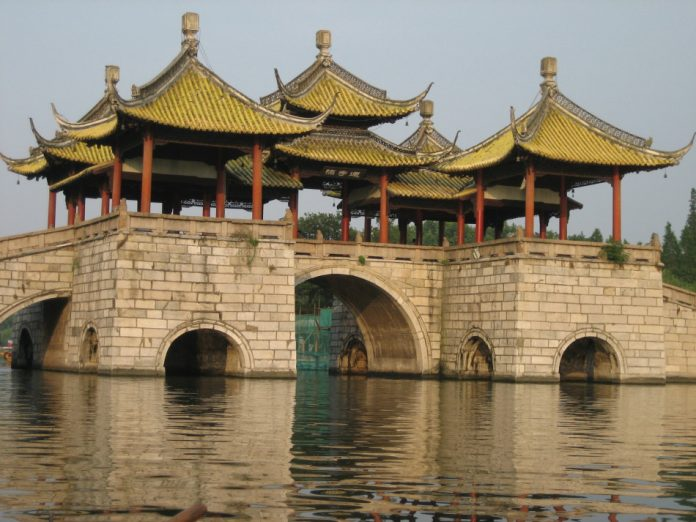 The composition of Wuting Bridge, or Five Pavillions Bridge, is unrivaled in China. It is formally called the Lianhua, or Lotus Flower Bridge, because of its resemblance to the open spreading petals of the lotus flower.