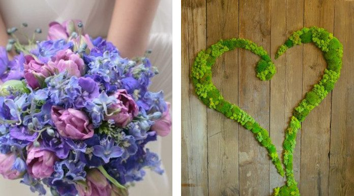 A bride holds a colorful bouquet designed by Luca Nuvoli, and a hear-shaped arrangement made up of green plants is seen on a wooden surface.