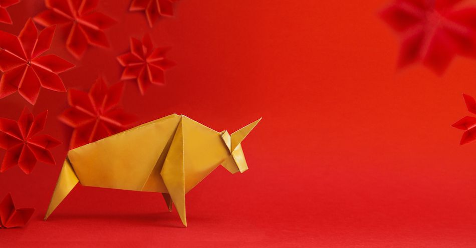 paper origami ox with red background