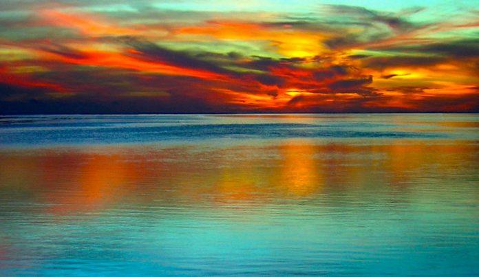 Colorful sunset at sea near Polynesia.