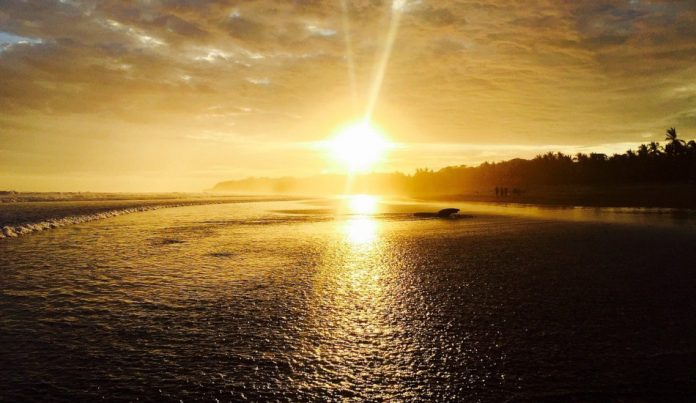 An ocean sunset along the coast.