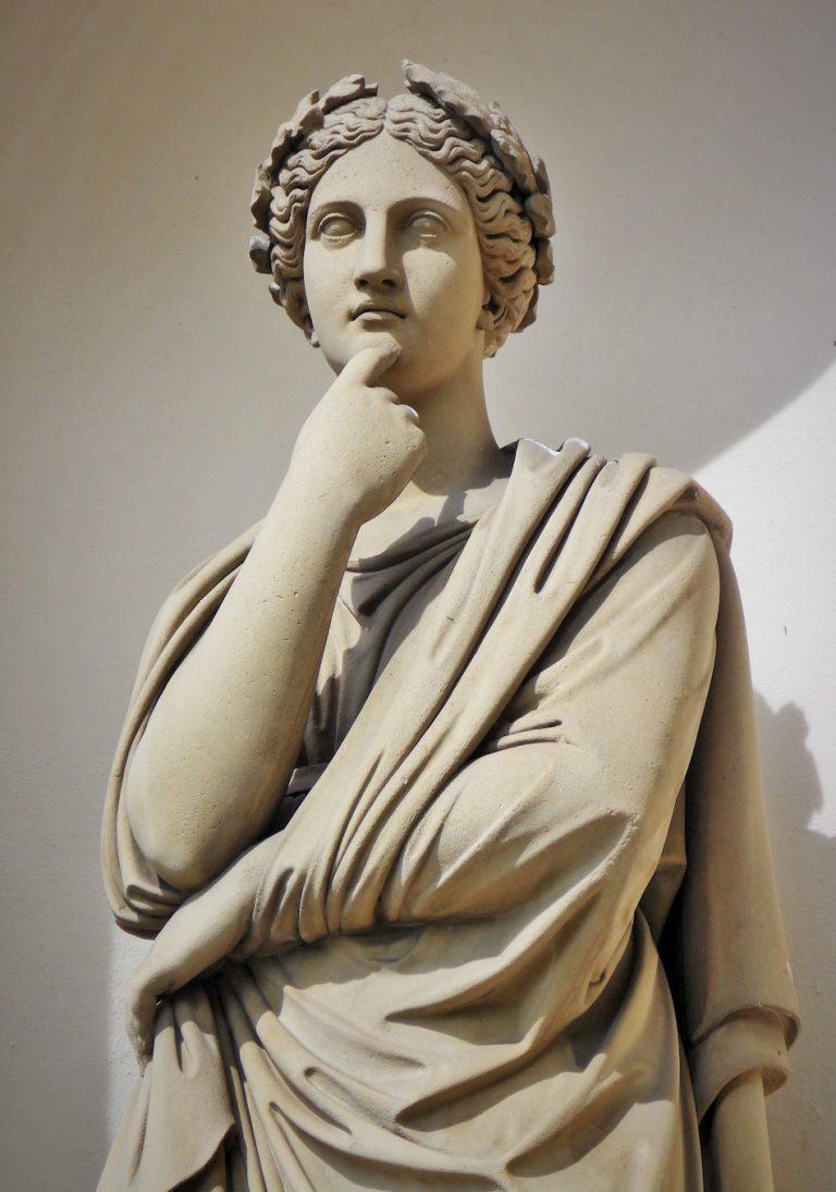Woman thinker statue.