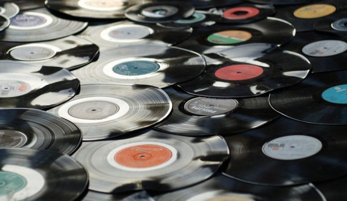 A pile of old vinyl records.