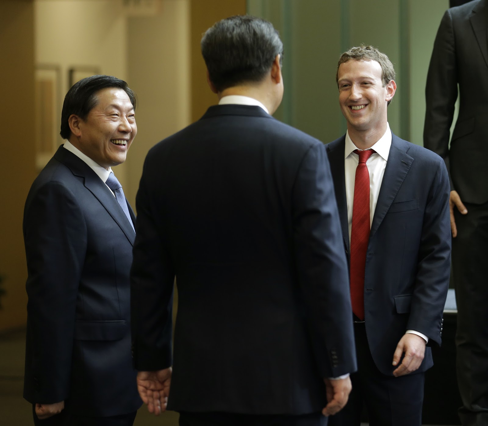 Chinese leader Xi Jinping (C) talks with Facebook Chief Executive Mark Zuckerberg (R) as Lu Wei, China's internet czar, looks on during a gathering of CEOs and other executives at the main campus of Microsoft Corp September 23, 2015 in Redmond, Washington. Xi and top executives from U.S. and Chinese companies discussed a range of issues, including trade relations, intellectual property protection, regulation transparency and clean energy, according to published reports.