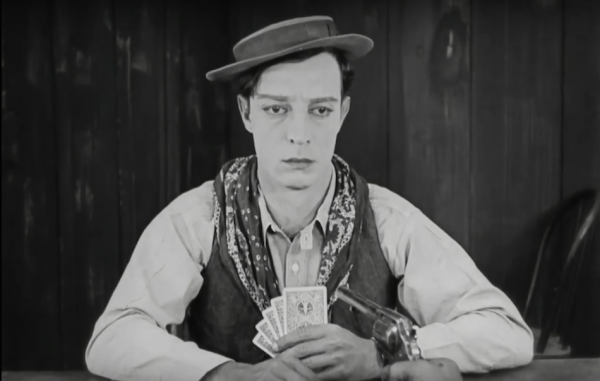 Buster Keaton with deck of cards in his hand.
