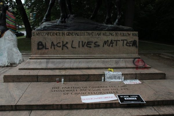 Vandalized General Lee and Stonewall Jackson monument in the wake of Charlottesville riots with the Black Lives Matter slogan and the symbol for anarcho-communism.