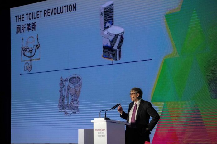 Bill Gates gives a speech during the