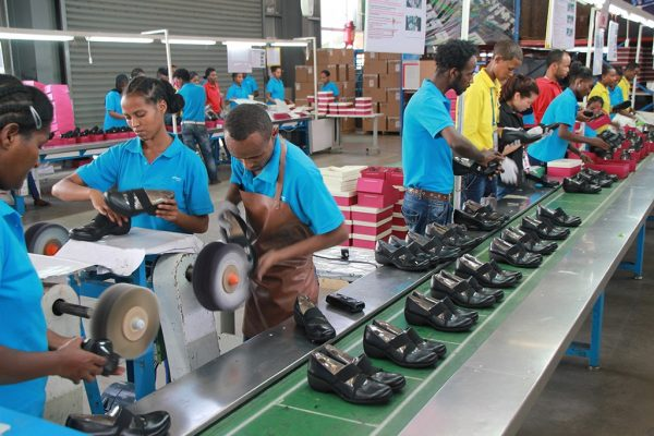 Factory workers laboring in a Huajian shoe factory in the Eastern Industrial Zone of Ethiopia
