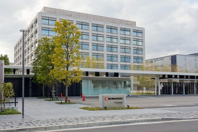 Photograph of the southeast side view of Shimadzu Corporation E1 Building (headquarters) in Nakagyo-ku, Kyoto, Kyoto Prefecture, Japan.