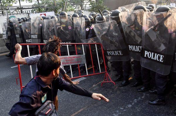 Thai-protesters-throw-barricade-at-riot-police-in-Bangkok
