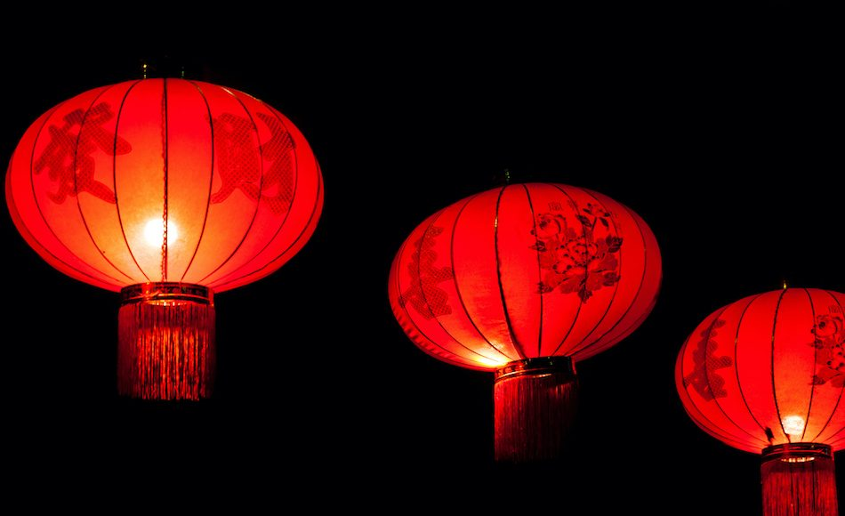 3 red chinese lanterns in the night