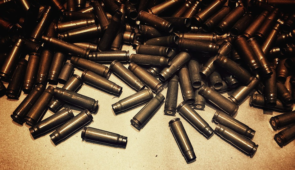 A pile of empty shell casings for bullets.