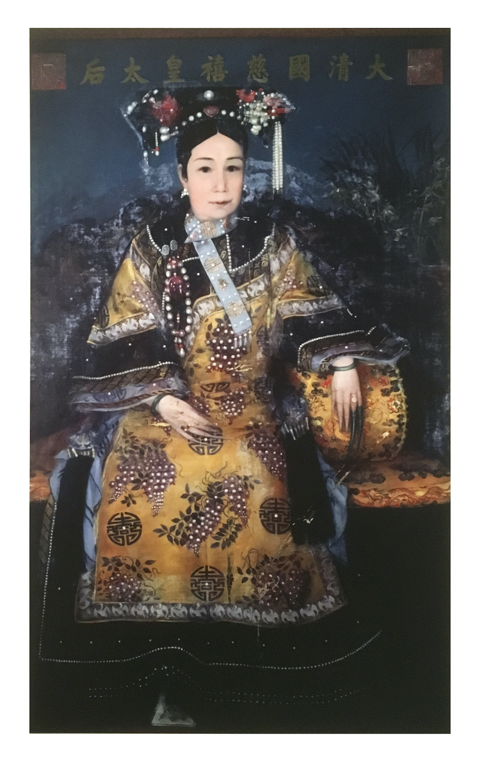 painting of Empress Dowager Cixi, Tongzhi Emperor's mother sitting in chair dressed in gold and black imperial clothing.