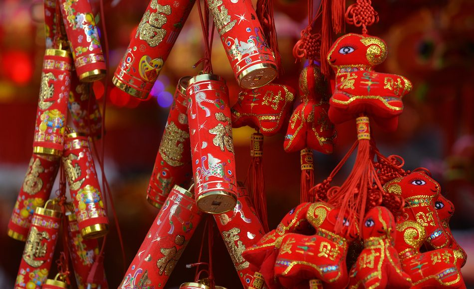 detail of firecrackers and red trinkets to keep away chinese new year monster nian