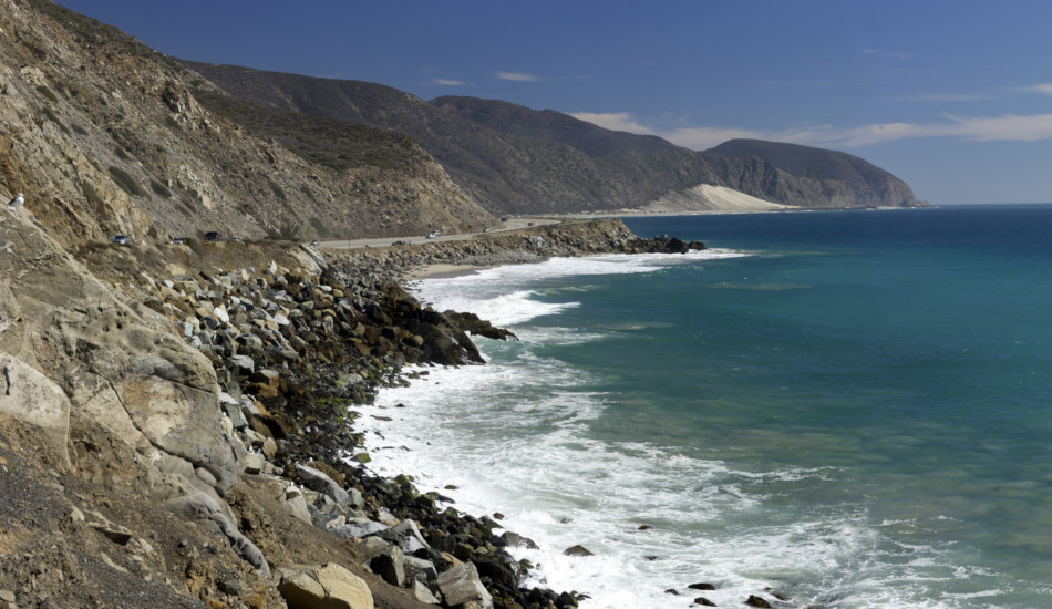 A section of California's Pacific Coast Highway winds its way along the ocean.