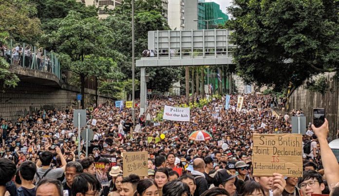 Street in Hong Kong full of protesters.