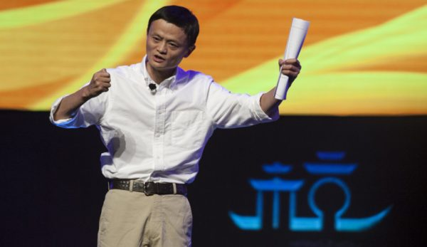 Jack Ma giving a speech on stage.