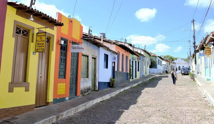 Quaint and colorful buildings lining a cobblestone street in Lençóis, Brazil.