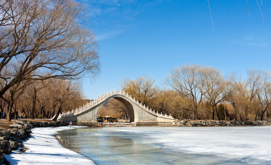 moon bridge from China over a frozen river on a winter day
